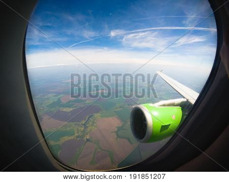 Aerial view through airplane window, travel concept