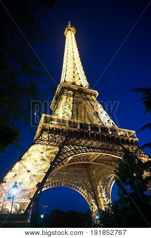 Paris France-June 1 2016 : Eiffel Tower with illumination at night in Paris France. Romantic travel background. Eiffel tower is traditional symbol of paris and love.