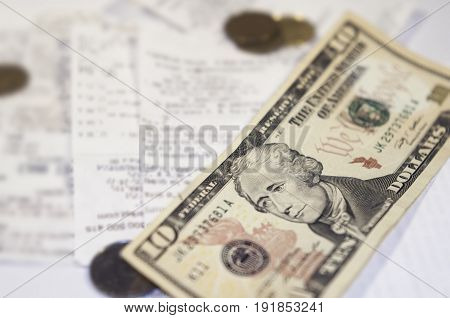 Payment of bills. A ten-dollar note and a receipt