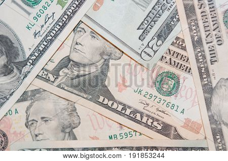 Background of scattered banknotes of different denominations