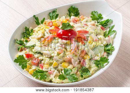 Fresh vegetable salad with chinese cabbage and surimi. Decorated with crab made from sweet pepper