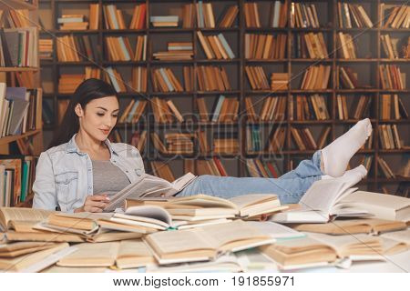 Young female study in the library reading book