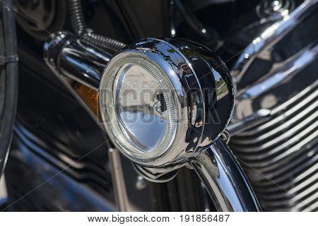 Old tourist motorcycle: detail lamp chrome mirror