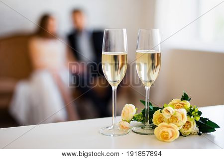 Valentine's Day Or Anniversary Concept - Glasses Of Champagne And Couple In Love