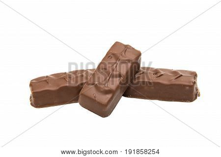 chocolate bar (nougat topped with caramel enrobed in milk chocolate) isolated on white background