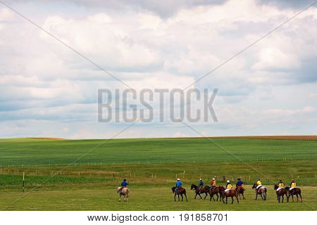 Nature landscape with group of recreational Polo players in Southern Alberta Canada