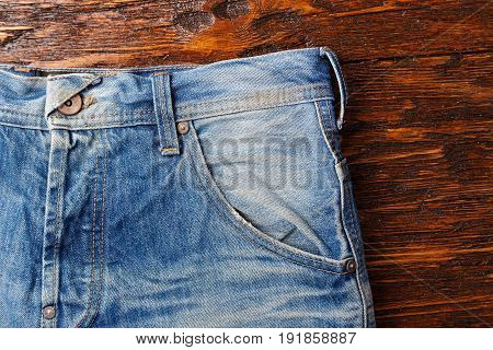 Jeans pockets. аbstract background of shabby and worn jeans horizontal photo.