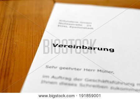 A letter on a wooden table - Agreement