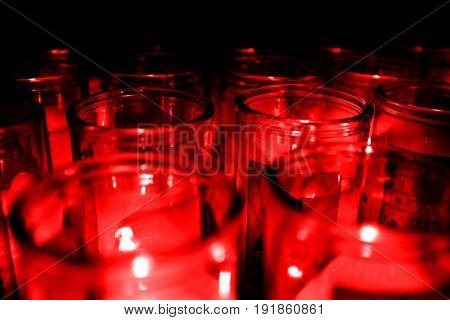 Glass jars of candelight candels red glow