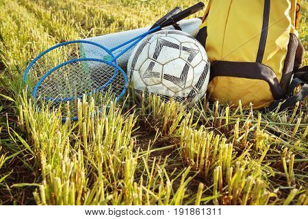 Things for a picnic rucksack, ball, racket, rug. Outdoor weekend outdoor picnic closeup. Have a great time outdoors