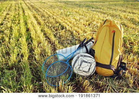 Things for picnics and outdoor recreation. Backpack, rackets for badbotton, ball, picnic mat. Going on a summer vacation relax holiday