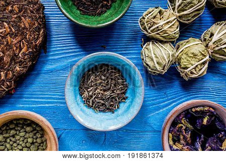 Drink herbal tea with brew on blue wooden table background top view