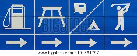 Fuel picnic camping and golfing highway sign