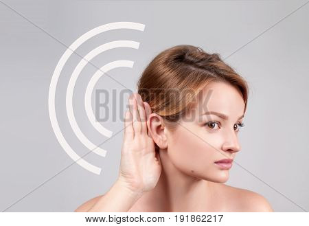 Woman Hold Hand Near Her Ear And Listening Carefully