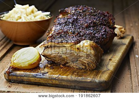 Roasted pork shoulder with onion and cooked sour cabbage