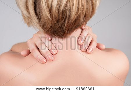 Young Woman With Shoulder Pain, Massaging Her Shoulder