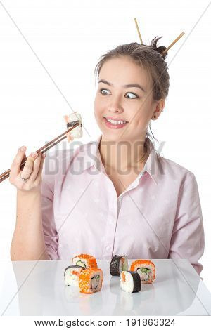 young woman with sushi smiling on white background