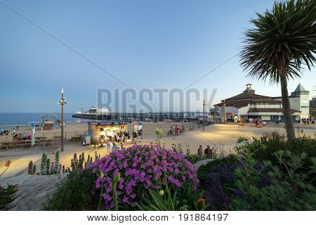 Bournemouth, UK. 17th June 2017. People are walking along the seafront by Bournemouth Pier and the beach.