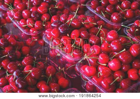 Cherries For Sale On Farmer's Market. Agriculture Background. Top View. Close-up