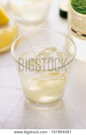 Bison grass vodka lemon drink with ice