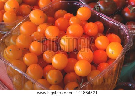 Yellow Cherry Tomatoes For Sale On Farmer's Market. Agriculture Background. Close-up. Top View