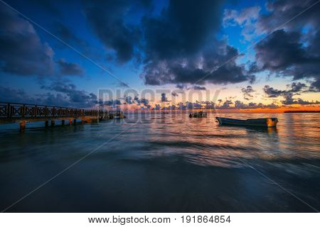 Sunrise over the Caribbean sea and speed boats