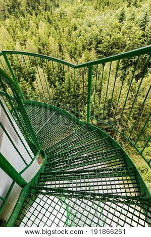 Green spiral staircase and railing on the lookout tower. High view tower view from the mine.