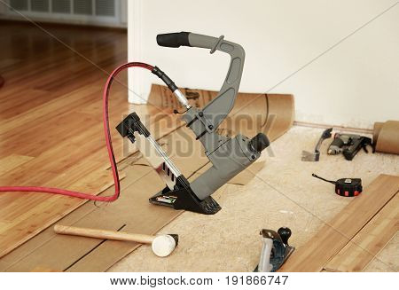 Installing of beautiful bamboo hardwood floor with pneumatic tool