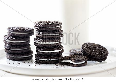 Oreo chocolate cookies filled with vanilla cream with glass milk