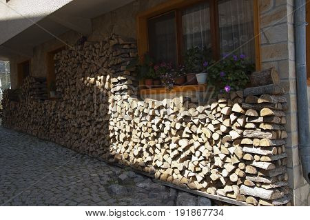 Sozopol Bulgaria - 22 Juny 2016: Firewood stacked by the wall of residental house