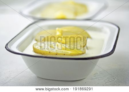 Buttermilk soup with baby potatoes in enamel bowls