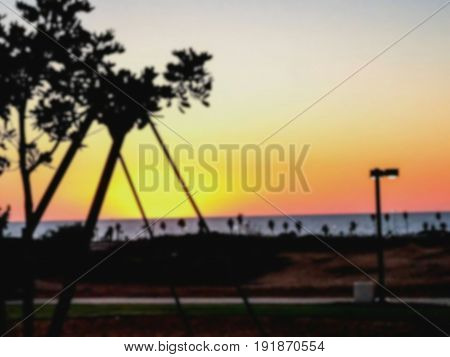Blured view of i beautiful tropical sunset from sea embankment