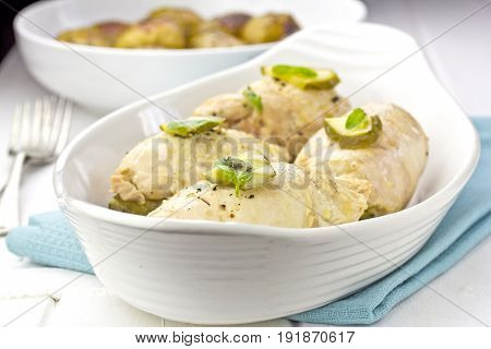 Chicken roulades stuffed with bacon and gherkins served with baby potatoes