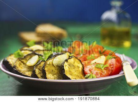 Aubergine & tomato salad with garlic with fresh brown bread