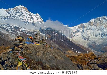 Mountain Landscape in Himalaya. Piramid of stones. Annapurna South peak, Nepal, Annapurna Base Camp.