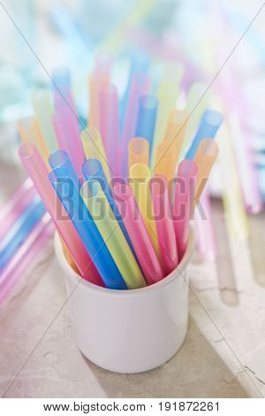 Colourful pink, blue, yellow, green straws for drinks