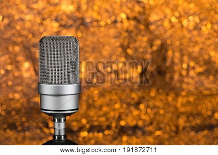 Professional Microphone On Orange Background Out Of Focus
