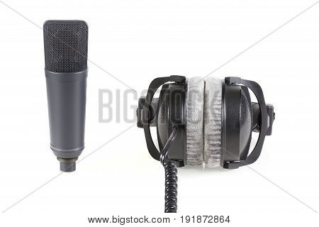 Professional headphone and microphone. On white isolated background