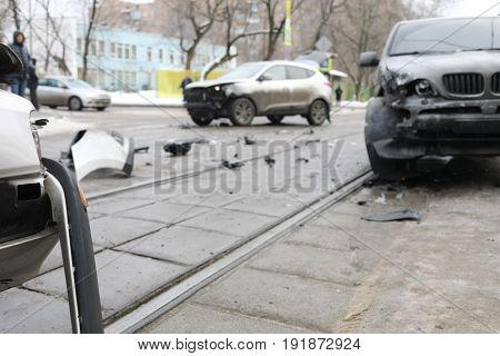 Group car accident with many damages on street with tram railways