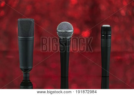 Three Microphones In Defocused Background And Red