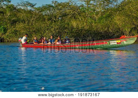 CUYABENO, ECUADOR - NOVEMBER 16, 2016: Unidentified people travelling by boat in Cuyabeno National Park, Ecuador.
