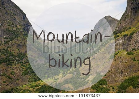 English Text Mountainbiking. Valley With Mountains In Norway. Peaceful Landscape, Scenery With Grass, Trees And Rocks.