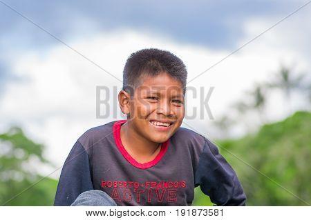 LAGO AGRIO, ECUADOR - NOVEMBER 17, 2016:Portrait Of Young Indigenous boy, of Siona community inside of Cuyabeno National Park, South America in Ecuador.
