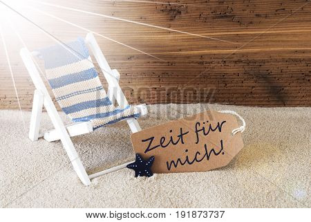 Sunny Summer Label With Sand And Aged Wooden Background. German Text Zeit Fuer Mich Means Time For Me. Deck Chair For Holiday Or Vacation Feeling.