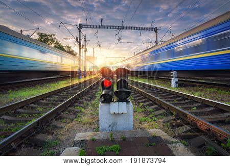 High Speed Passenger Trains In Motion On Railroad Track