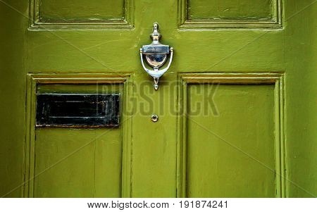 Door with brass knocker in the shape of a hand beautiful entrance to the house home decor