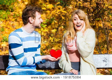 Man Show Feelings To Girl In Autumnal Park.