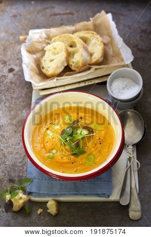Autumn butternut squash soup with herbs and cream