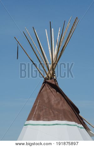 Architectural detail of tipi or teepee against blue sky