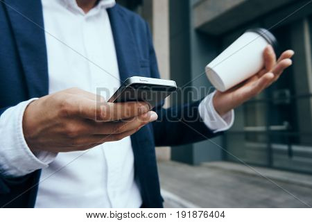 Businessman, businessman with phone, businessman holding coffee.